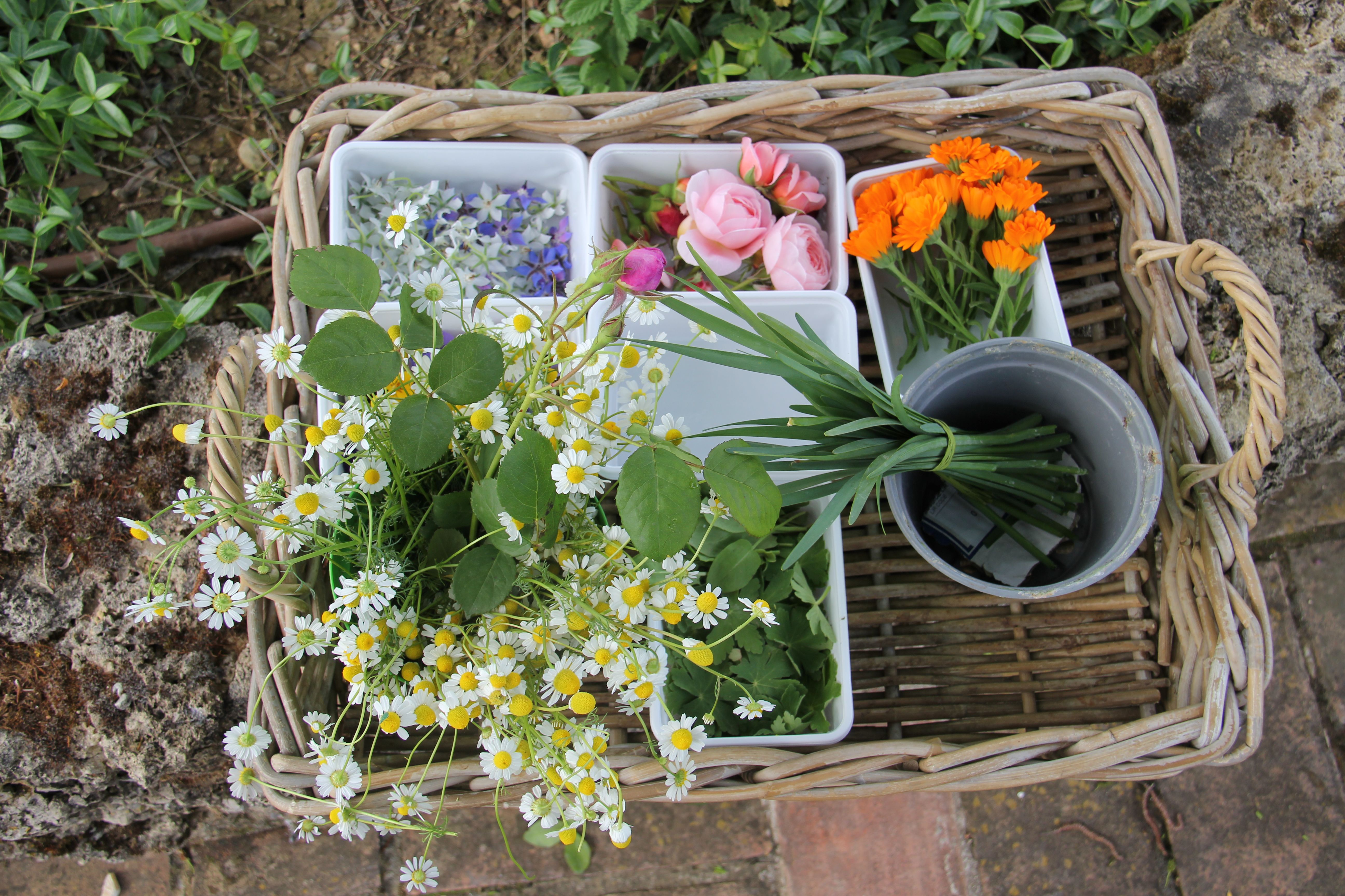 The herbs and flowers are chosen for the evening's presentations