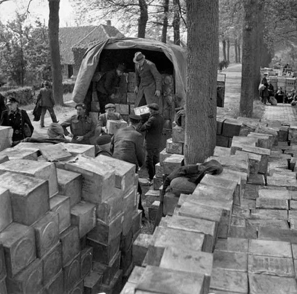 Dutch civilians loading a Canadian-supplied truck with food,following agreement amongst Germans, Dutch and Allies about the distribution of food to the Dutch population.  Date: 3 May 1945 Wageningen, Netherlands (vicinity)