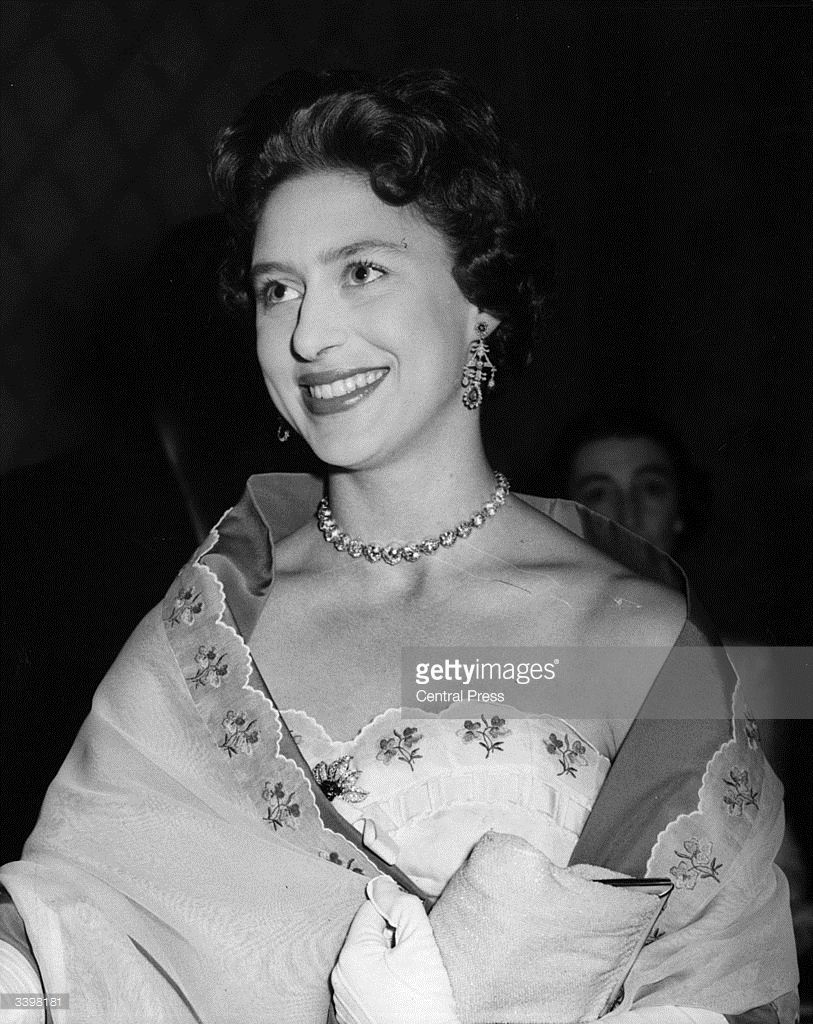 Princess Margaret (1930 - 2002) arriving at London's Hurlingham Club to attend a ball in aid of King George's fund for sailors.