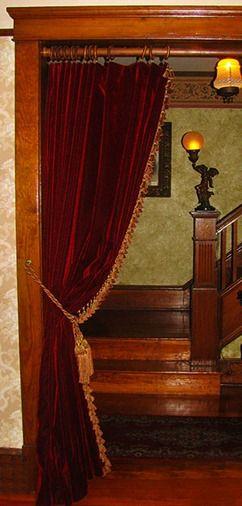 Velvet curtains in doorway..very popular with Victorians