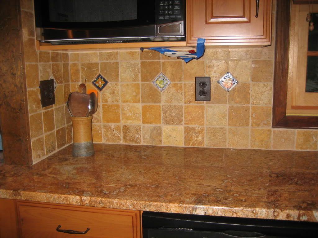 interesting marble backsplash kitchen walls | The kitchen perimeter countertops are rich chocolate honed ...