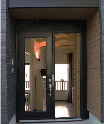 Porte noire en acier un produit r put qui rehausse le look de votre demeure porte ext rieur for Porte exterieur noir