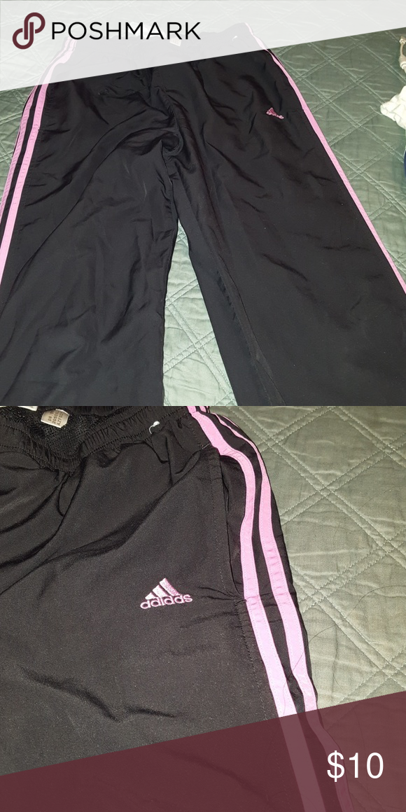 0f81f91bbfb Women's Adidas sweat pants Black with pink lines on side Bottom part has  zippers on side Great condition adidas Pants Track Pants & Joggers