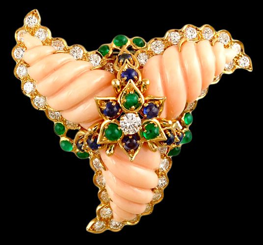 Cartier New York stunning Angel Skin Coral triple swirl pin set with diamonds, sapphires and emeralds.  Approx. 6.35cts. of diamonds. Circa 1970's