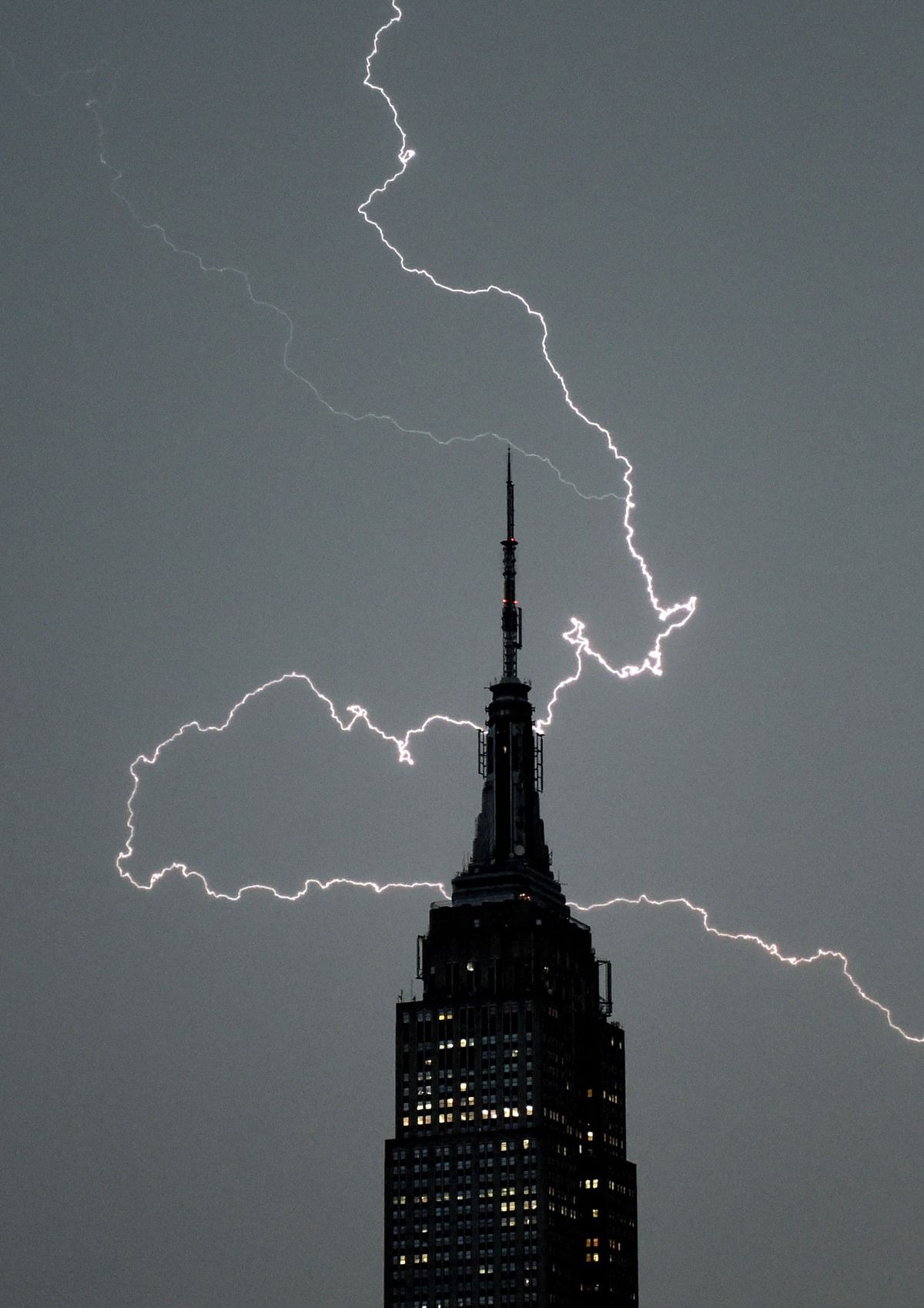 outlet store 3f0bd abfce Lighting strikes over the Empire State Building as a major storm comes in  New York City July 2, 2014.