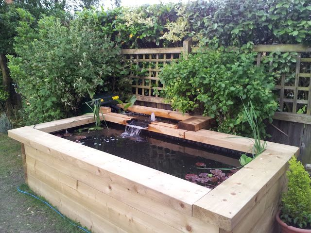 Patio fish ponds raised pond sleeper ideas pinterest for Raised garden pond ideas