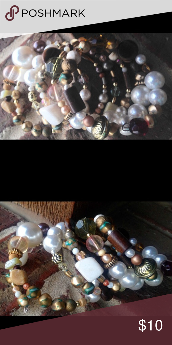 Shabby chic beaded bracelet.  Earth tones Shabby chic beaded bracelet.  Earth tones and gold accents. Made with new and vintage beads from salvaged vintage jewelry. Memory wire that is long and can fit any size wrist. Jewelry Bracelets