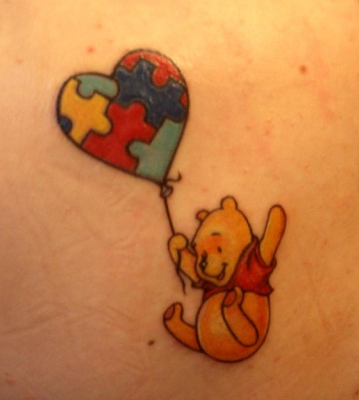 Autism speaks whinnie the pooh tattoo, that I want behind my ear