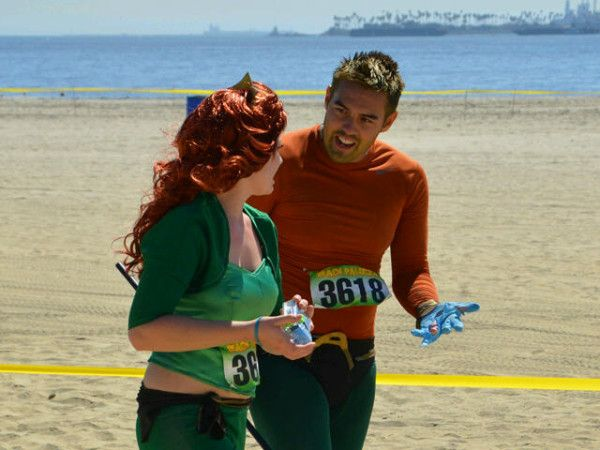 Aquaman and...the caption says Ariel but I think that's Mera.