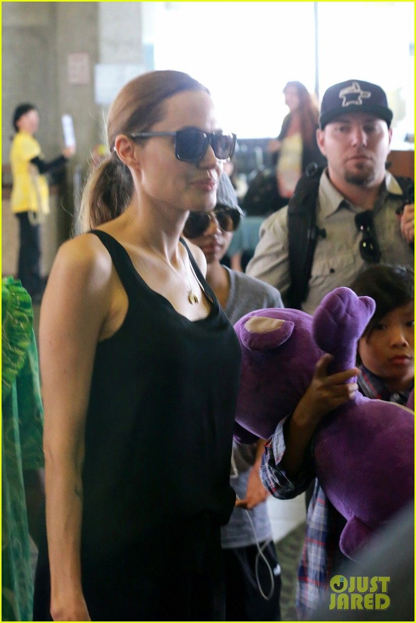 Angelina Jolie arrives on a flight in Hawaii with her boys Maddox and Pax on July 7, 2013