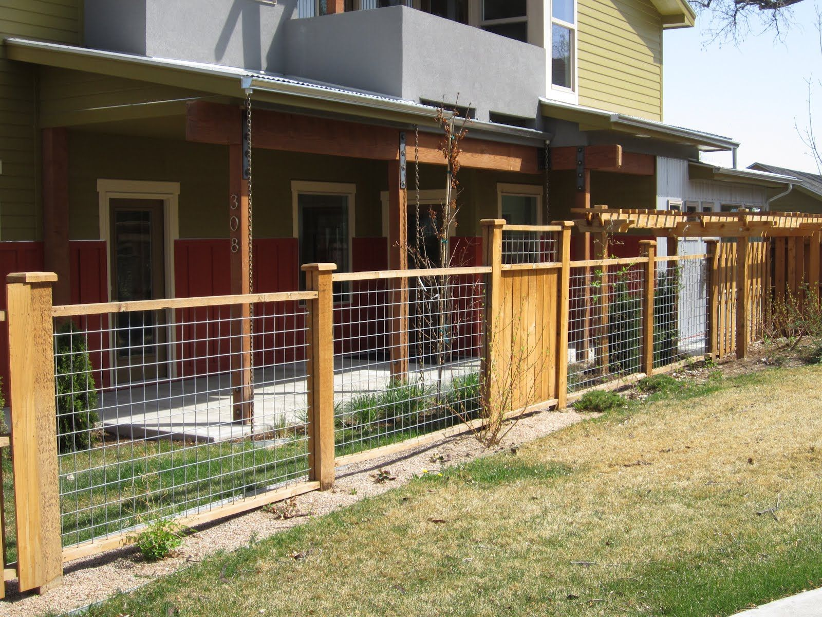 Yard fence ideas mix of hog wire fencing and wood panels for Front garden fence designs