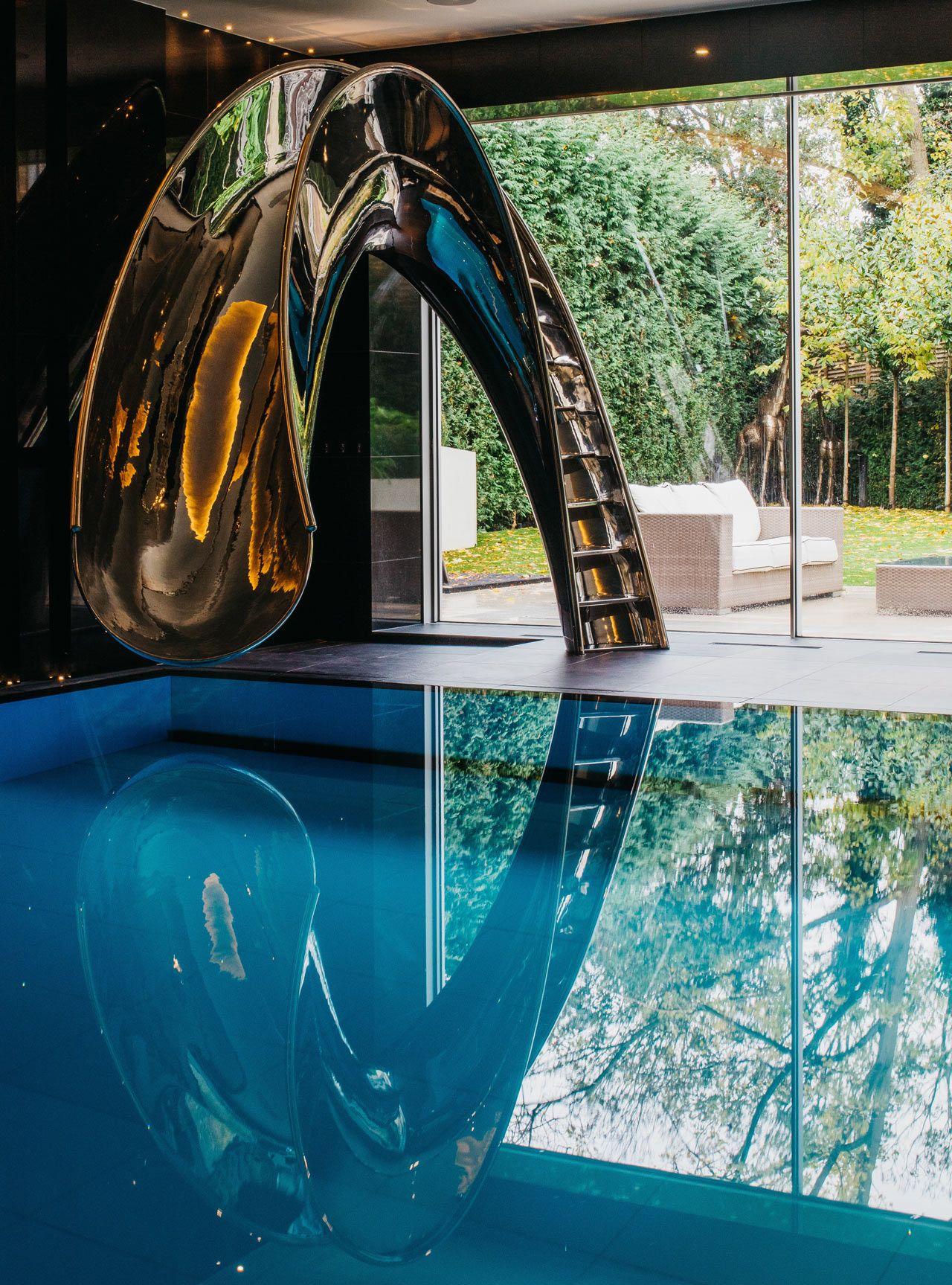 Sleek Sculptural Water Slides For The Modern Pool Indoor Pool Design Indoor Swimming Pool Design Indoor Pool House