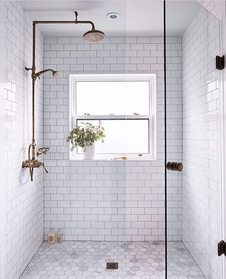 Clean white tiles give this bathroom a modern feel but the shower