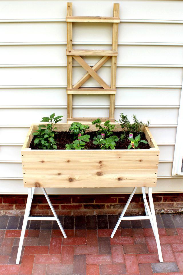 """Learn how to make an elevated cedar planter box 36"""" by 19 3/4"""" and 11"""" deep with trestle legs. Perfect for herbs and a few vegetables or flowers!"""