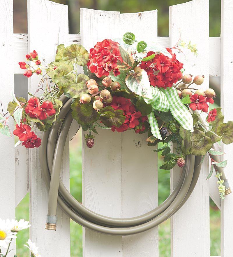 garden hose wreath! love this! Wish we had a gate...