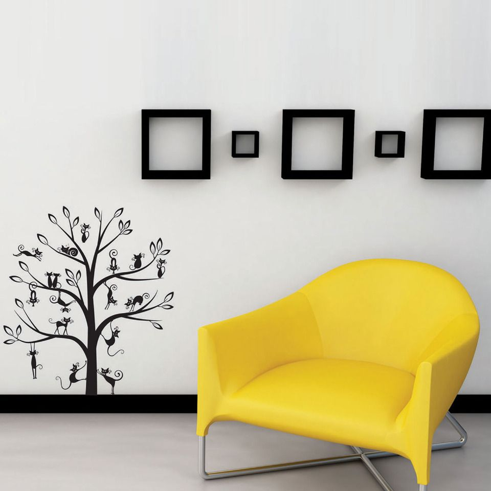 I don\'t like the chair, but I love the little tree with the kitties ...