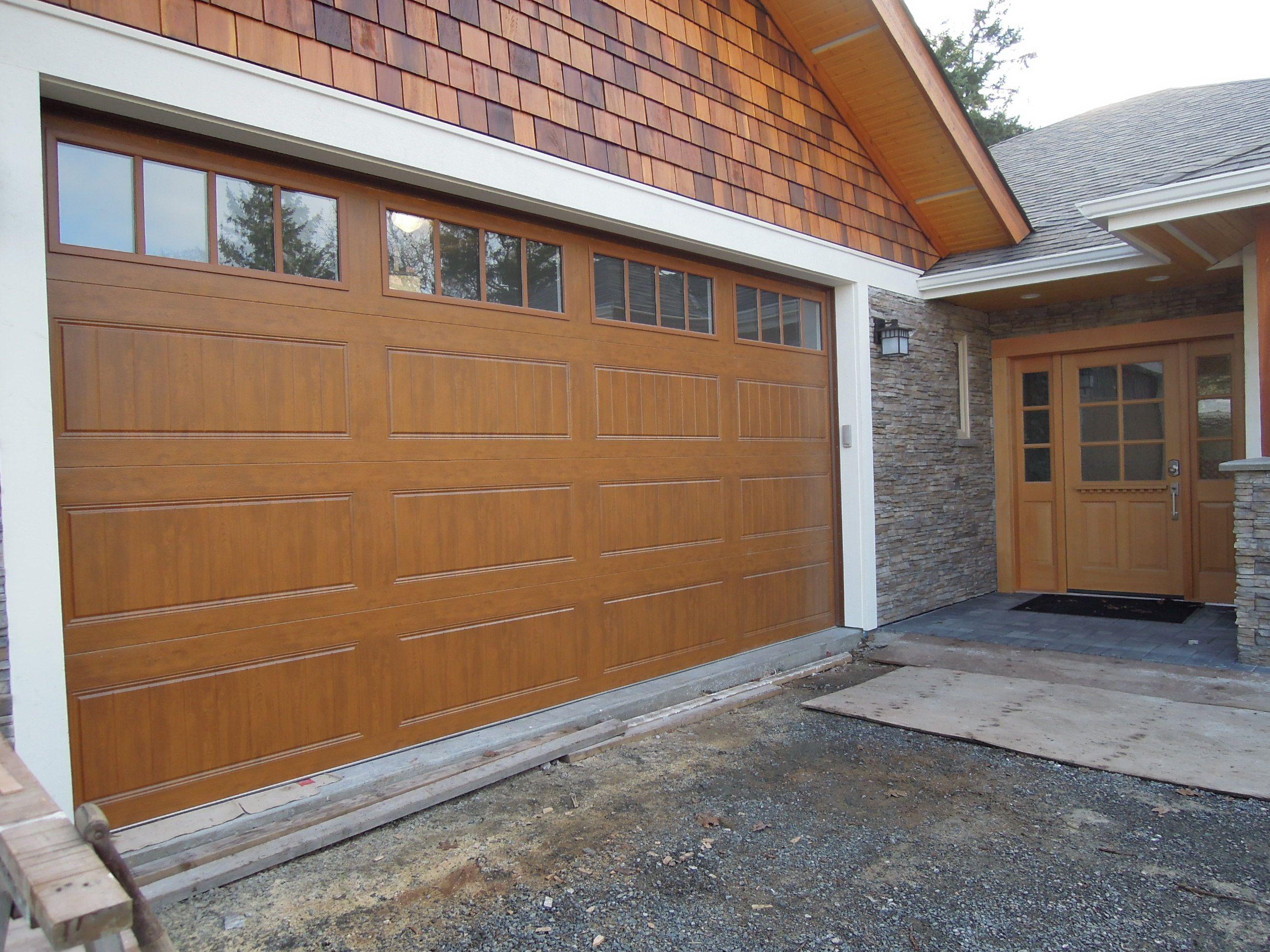 Gallery Garage Door - Clopay Gallery Ultragrain medium oak finish model with Rectangular grilles. Installed by Harbour Door Victori. & Gallery Ultragrain medium oak finish model GD1LP with Rectangular ...