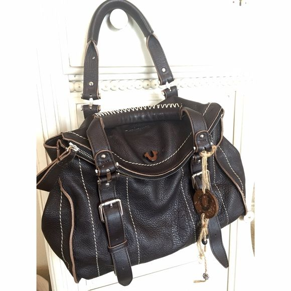 True Religion Leyla Shoulder Bag Color: Dark Brown. Material: Leather. Measurements: 13.5 x 12 x 5 inches. Zipper closure. Inside: zip pocket and two pouch pockets. Barely used! Excellent condition. No Trades. True Religion Bags Shoulder Bags