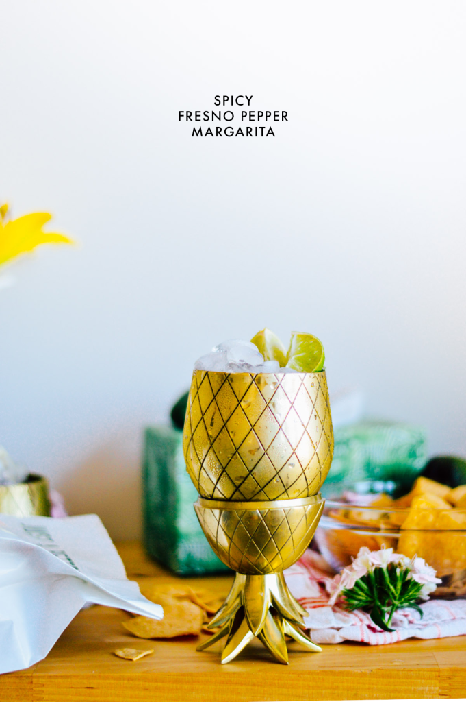 Try this spicy fresno pepper margarita drink recipe with fresh guac, chips, and tacos! | bygabriella.co