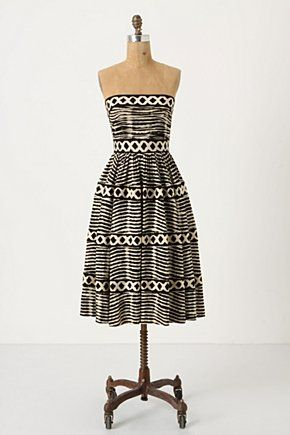 I love this - with a big brown belt and bright red shoes! Seems perfect for a summer party...