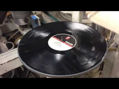 Here Is A Wide Angle View Of The Vinyl Record Press In Action Notice That Each Record Is Automatically Sleeved Rather Than Stacked Vinyl Records Vinyl Records