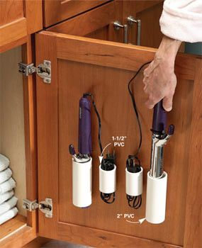 "Save Drawer Space: Cut 2-3"" PVC tubes into 4"" lengths and adhere the pipes to the inside of cabinet doors. These work great to store coiled cords and hair appliances."