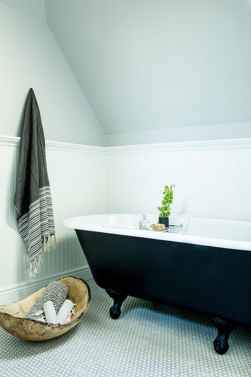 White and gray bathroom features gray paint on upper walls and ...