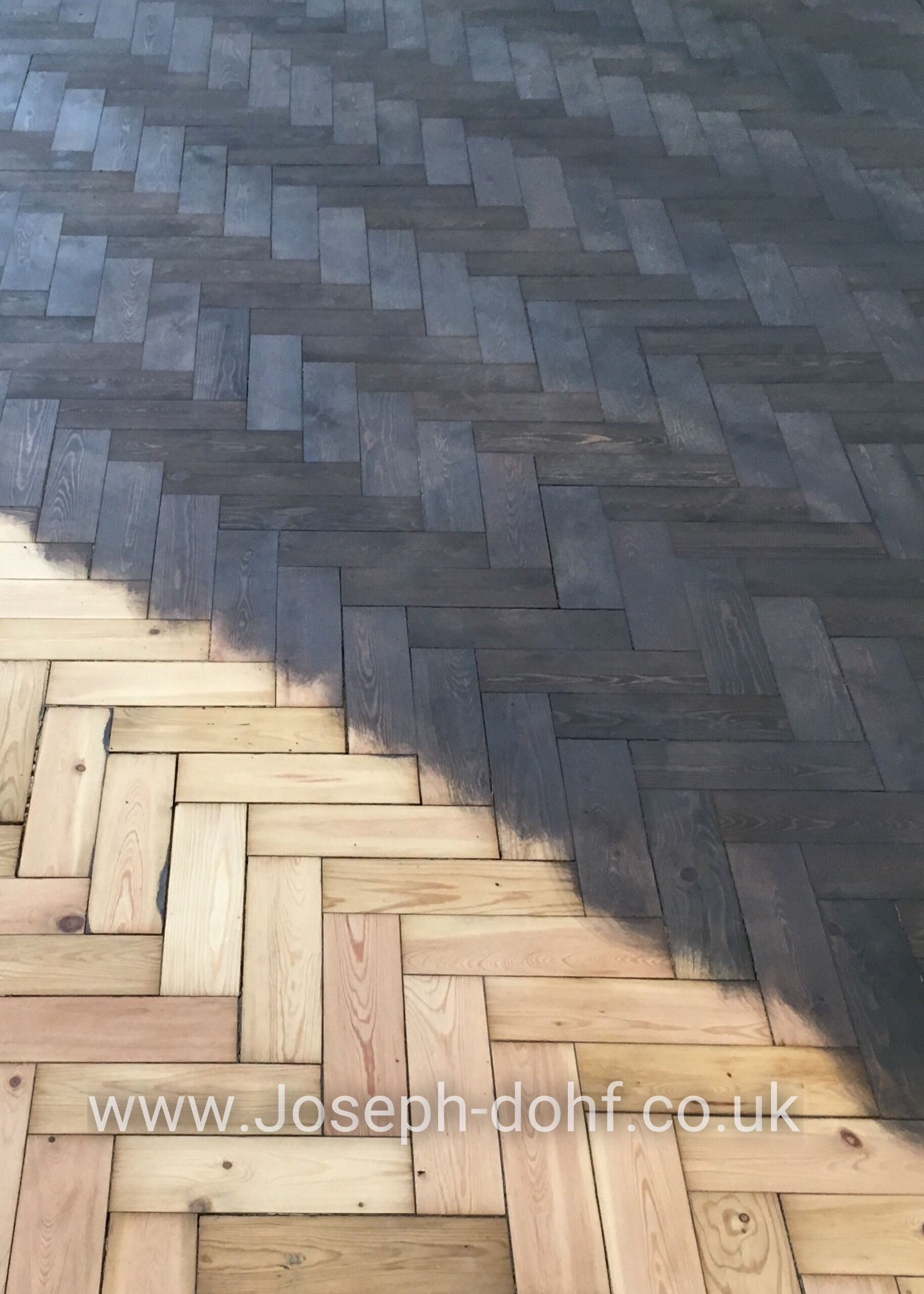 Reclaimed parquet pine floor, sanded and stained with one coat of grey colour look.