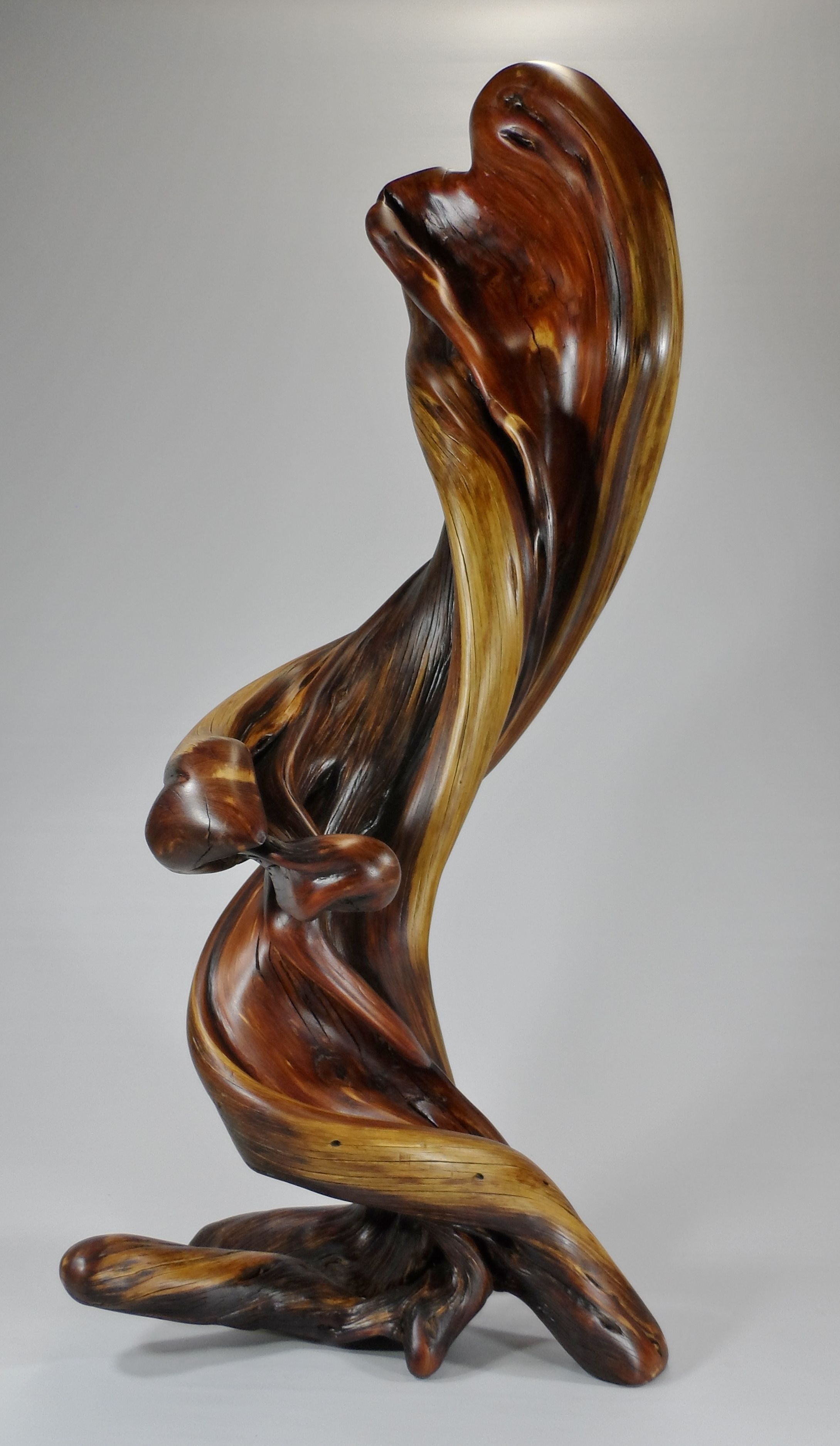 Standing natural wood sculpture art