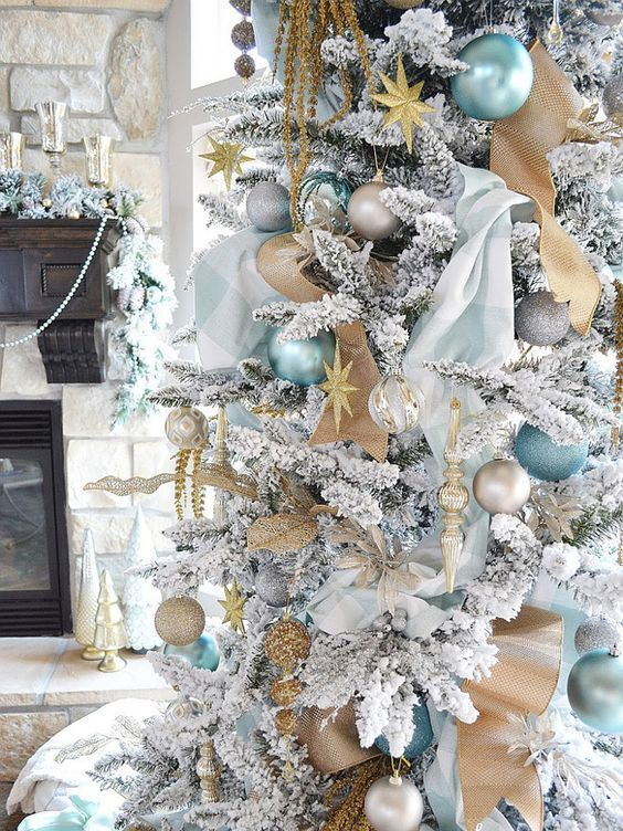 blue and gold decor is ideal for a white christmas tree - White Christmas Tree With Gold Decorations