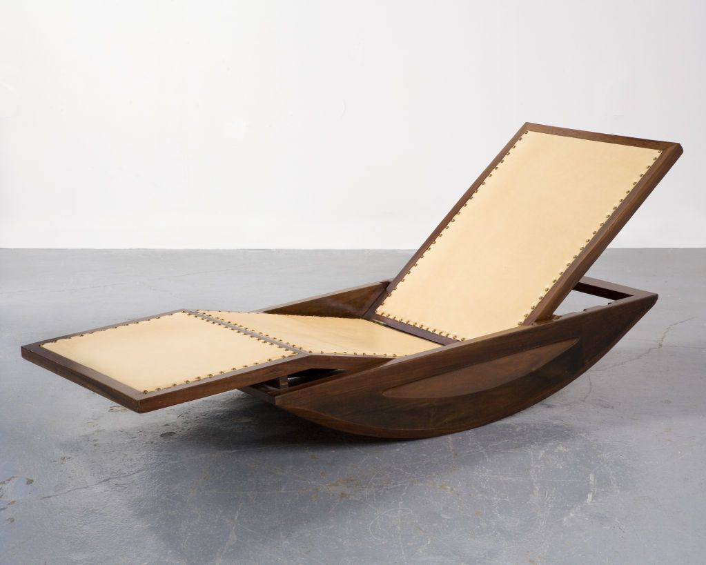 Designed in the 1940s by Joaquim Tenriero, pioneer of modernist Brazilian furniture, this unique rocking chair has a frame made from solid jacaranda wood.