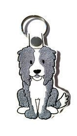 Black and White Border Collie Puppy Image Black Leather Keyring in Gift Box