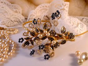 A dramatic statement piece in gold tone with smokey crystals and black enamel. Surrounded with vintage faux pearls and crystals. A sumptuous head turner! Visit www.tilly-minxvintage.co.uk