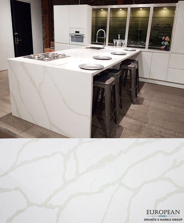 This Kitchen Island Is The Center Of Attention With Its Waterfall Countertop Design This