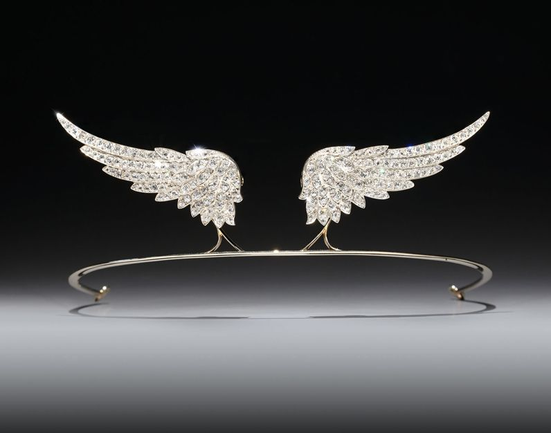 A diamond tiara, formed from two antique old brilliant cut diamond wings set in silver and mounted on gold, the wings are detachable and come with fittings allowing them to be worn as brooches. (=)