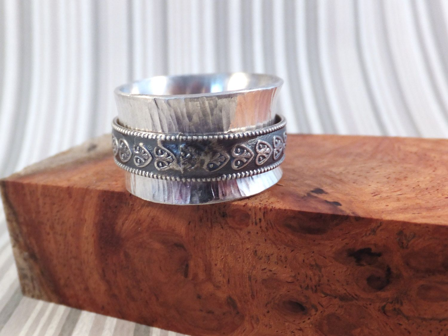 Sterling silver wide band spinner ring  hand textured band & shield design accents by BKDStudio on Etsy