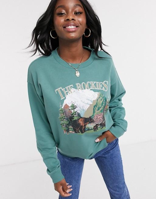 ASOS DESIGN sweatshirt with vintage Canada print |