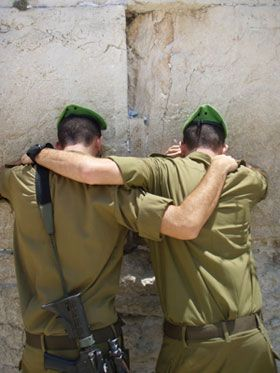 Brothers in arms. Two IDF soldiers daven at HaKotel HaMa'aravi.