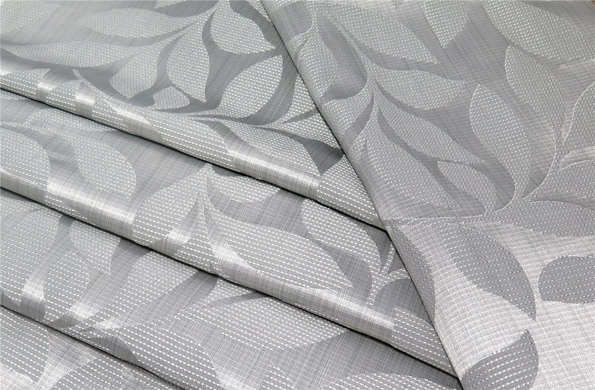 Charlotte is a versatile and modestly priced cloth available in thirteen subdued pastel and neutral tones.  Contrasting satin and matte finishes come together to create a contemporary trailing leaf design, with subtle horizontal thread detailing bringing the look together.  #charlesparsonsinteriors #fabric #material #drapery #curtains #grey #leaf