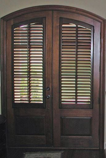 Arched Stained Doors Can Be Covered With Custom Stained