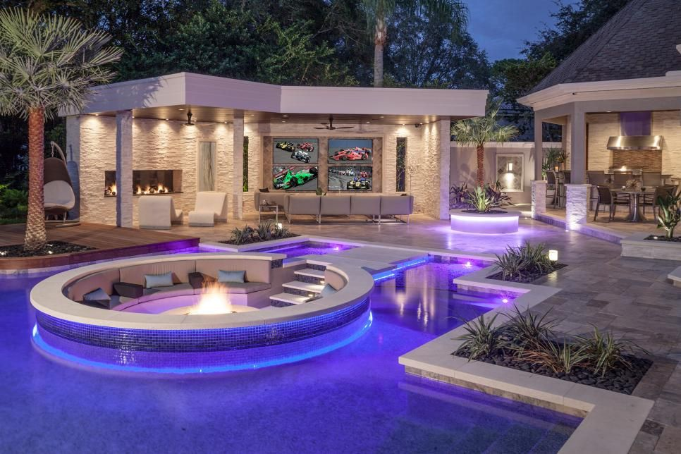 This Tropical Pool Features A Sunken Seating Area With Fire Pit And Is Surrounded By Attractive Stone Pavers An Ipe Wood Walkway In Wall