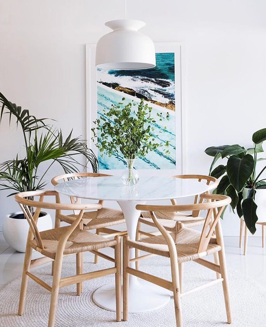 Beachy dining room decor with tulip table and wishbone