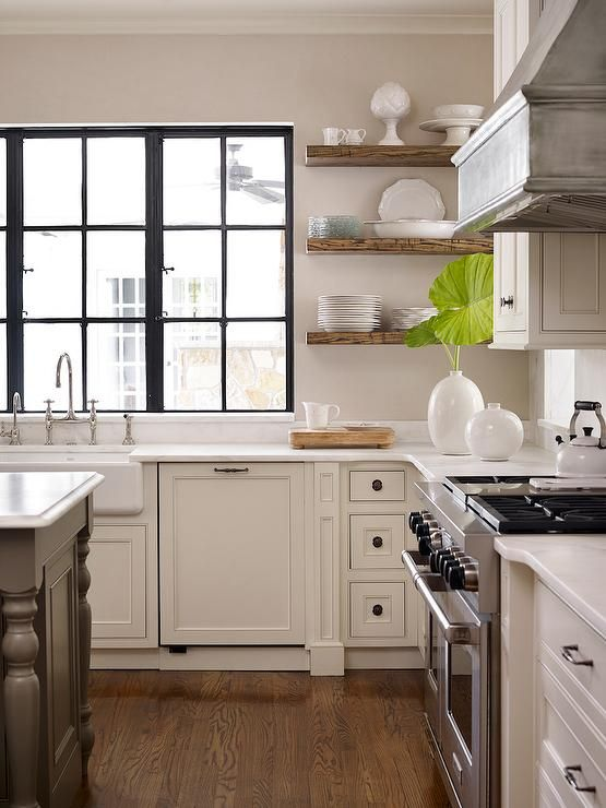 Dreamy Kitchen With Ivory Cabinets Floating Wood Shelves Black Windows Mid Tone Wood Floor Wood Floor Kitchen Wood Floating Shelves Floating Shelves Kitchen