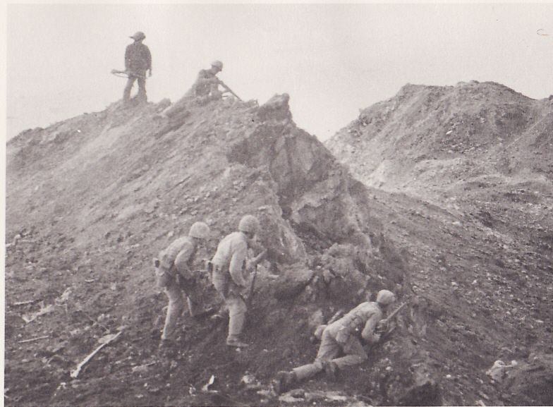 Marines during the first flag-raising on Iwo Jima, courtesy of Betty Michels McMahon, daughter of Jimmy Michels, one of the first flag-raisers. More about the event and its aftermath: http://www.boysofwwii.blogspot.com/2011/04/two-flags-of-iwo-jima-i-met-him-in.html
