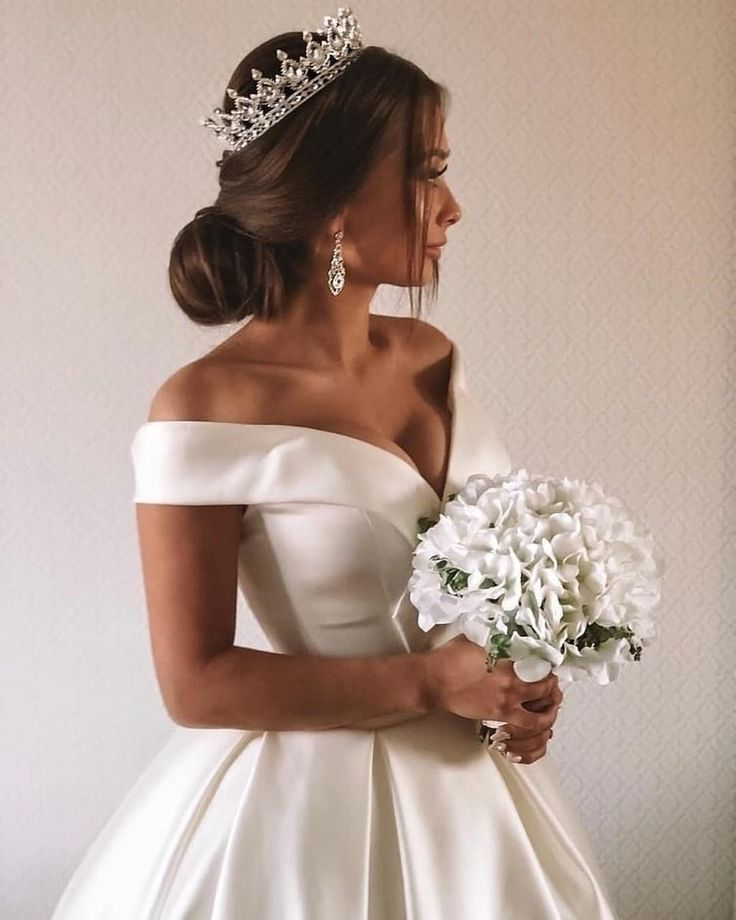 Photo of Simple Ivory Wedding Dresses with Sleeves