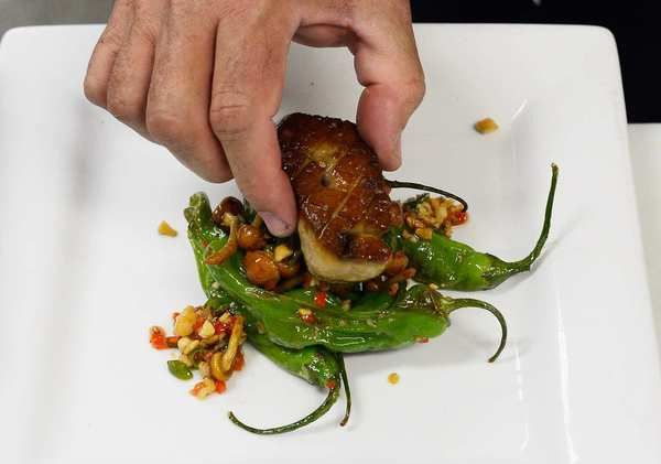 """Chef Sean Chaney of Hot's Kitchen in Hermosa Beach prepares foie gras with shishido peppers to serve at a """"Farewell Fois Gras"""" event on Friday."""