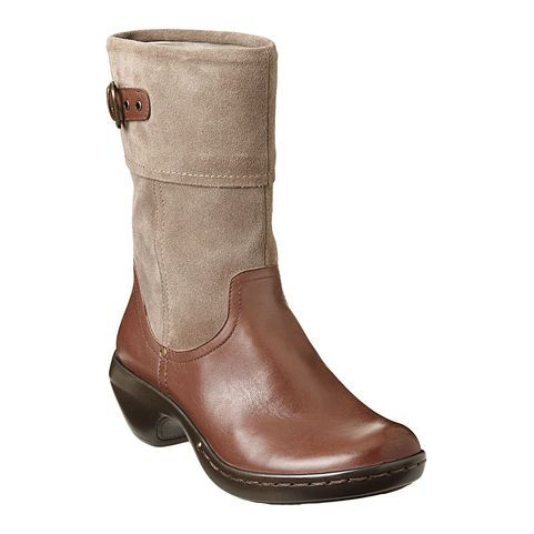 "This mid-calf foldover boot has a buckle detail at top for added style. An easy slip on boot with side zipper closure. These boots are lightweight and have super cushioned insoles for all day comfort. The contoured footbed provides ultimate support making them perfect for running errands all day or your perfect travel shoe! A 2 1/2"" heel sits on a 1"" base (equivalent to a 1 1/2"" heel). 7"" shaft and 13"" circumference."