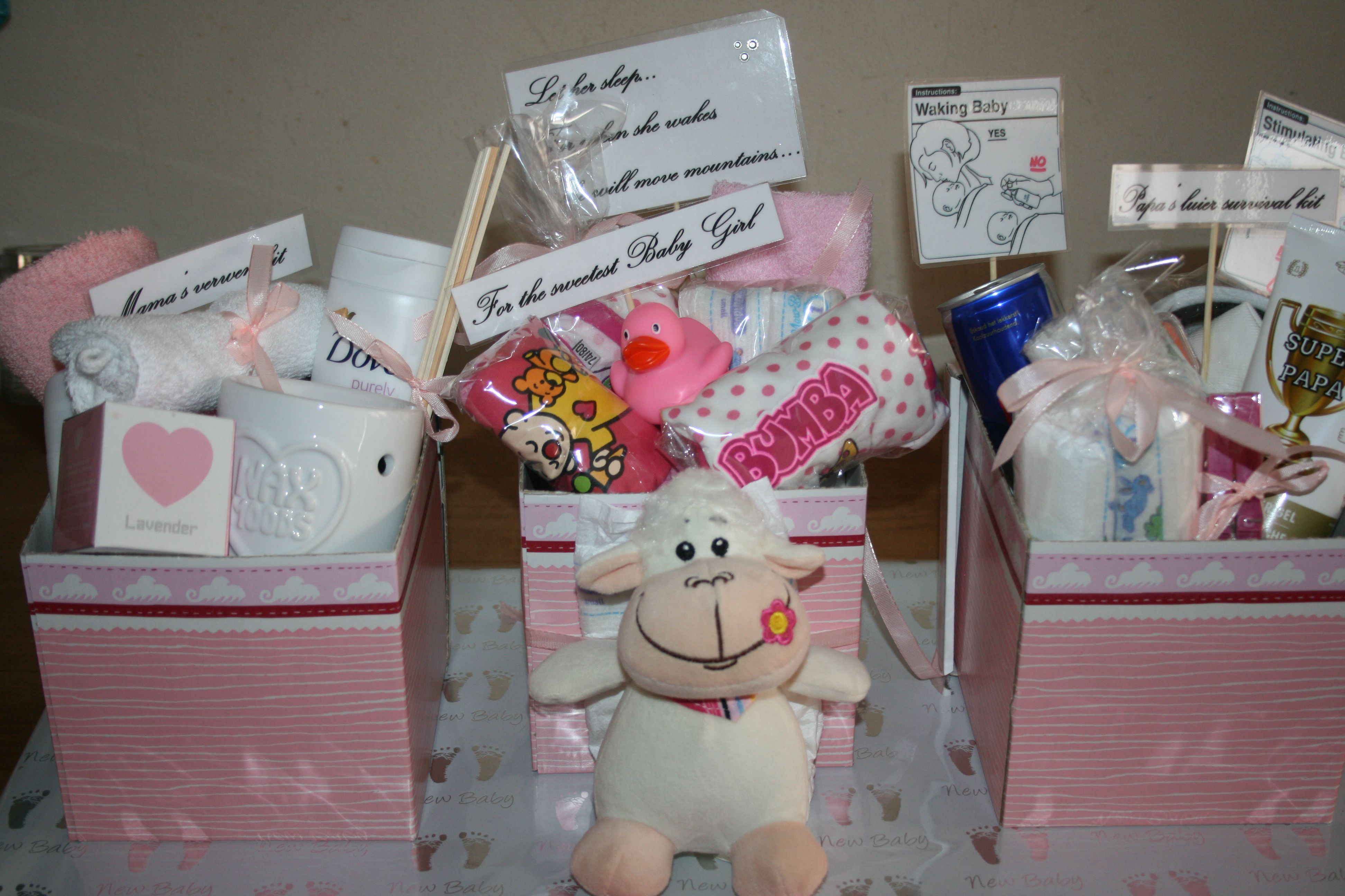 Babyshower gift....three boxes filled with presents for mum,baby and dad!