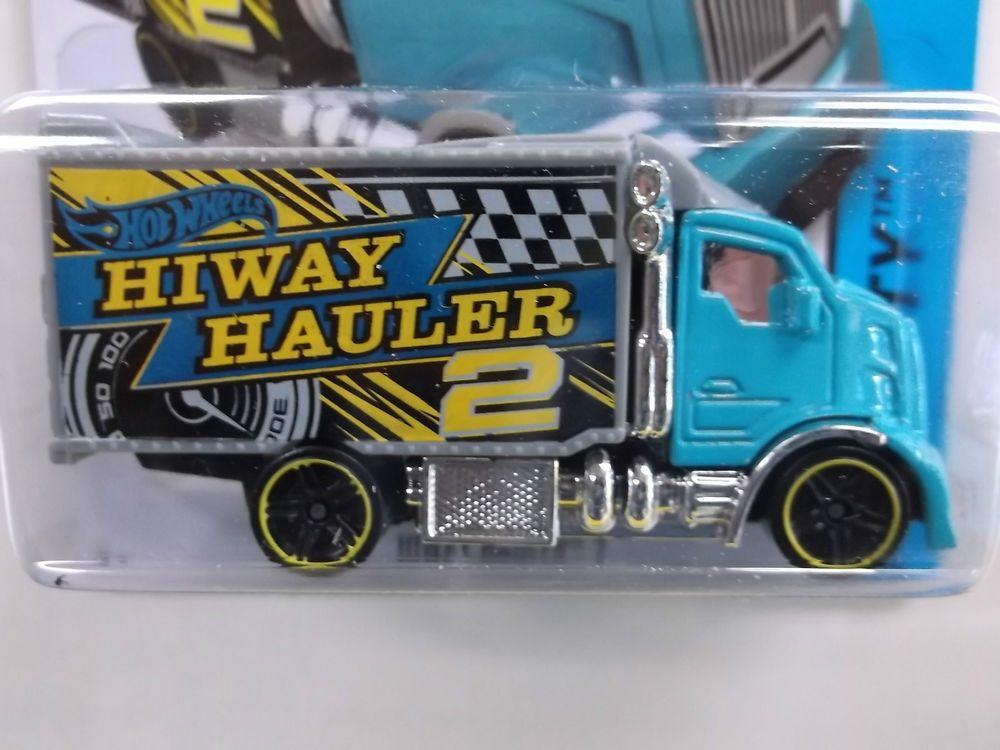 2014 HW #6/250 Hiway Hauler 2 in blue & grey w/ black PR5 spokes w/ yellow line