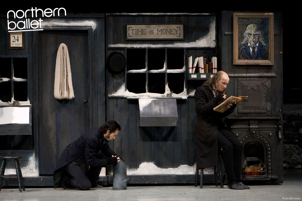 Northern Ballet dancers Hironao Takahashi as Bob Cratchit with Darren Goldsmith as Scrooge. Photo Bill Cooper. northernballet.com/christmas